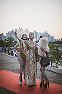 Three women stand on the red carpet and take a selfie as they prepare to enter the annual Gatsby party  at the Seoul marina and yacht club in Seoul, South Korea.<br /> <br /> (September 28, 2019)