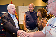 "July 10, 2010 - PHOENIX, AZ: US Senator JOHN MCCAIN (R-AZ) shakes hands with a supporter of his opponent, JD Hayworth, after a town hall meeting in Phoenix. Sen. McCain held a ""town hall"" meeting at a hotel in Phoenix Saturday morning. He criticized the Obama administration's handling of the war in Afghanistan, specifically the July 2011 date for the beginning of the withdrawl of US forces, the administration's handling of the immigration and border security issue and the recently passed health care reform bill, which he called ""Obamacare."" McCain is in a primary battle with former Congressman JD Hayworth, he did not mention Hayworth, by name during the meeting.   Photo by Jack Kurtz"