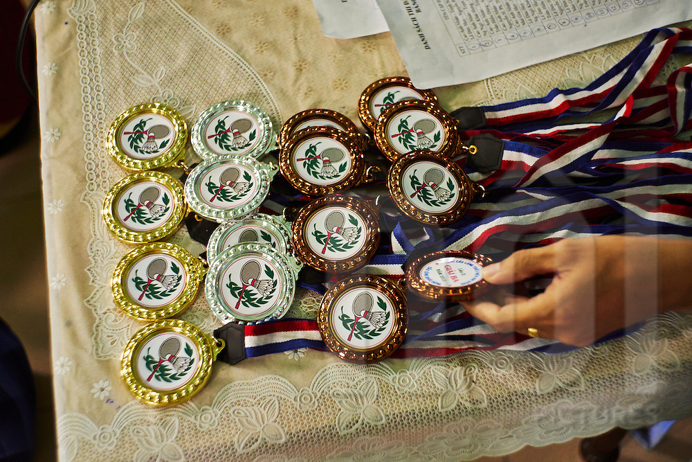 Winning medals for a Badminton Tournament laid out on a table, Ho Chi Minh City, <br /> Vietnam, Southeast Asia