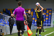 AFC Wimbledon manager Glyn Hodges weatches Bristol Rovers defender Luke Leahy (3) taking a throw in during the EFL Sky Bet League 1 match between AFC Wimbledon and Bristol Rovers at Plough Lane, London, United Kingdom on 5 December 2020.