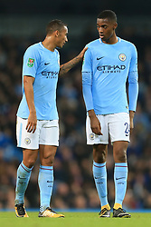 24th October 2017 - Carabao Cup (4th Round) - Manchester City v Wolverhampton Wanderers - Danilo of Man City (L) speaks to teammate Tosin Adarabioyo - Photo: Simon Stacpoole / Offside.
