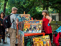 Artist tries to sell her paintings in front of the Metropolitan Museum