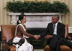 September 14, 2016 - Washington, District of Columbia, United States of America - United States President Barack Obama shakes hands with State Counsellor Aung San Suu Kyi of Myanmar (Burma) in the Oval Office of the White House on September 14, 2016 in Washington, DC. .Credit: Aude Guerrucci / Pool via CNP (Credit Image: © Aude Guerrucci/CNP via ZUMA Wire)