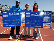 Kerron Clement (left) and Sanya Richards aka Sanya Richards-Ross (right) pose with Paul Tsuchiya, Vice President of Event and Sponsorship Marketing for Visa USA, at the USA Track & Field Championships at the Home Depot Center in Carson, Calif. on Sunday, June 26, 2005.