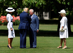 The Prince of Wales and the Duchess of Cornwall (right) meet US President Donald Trump and his wife Melania as they arrive in Marine One at Buckingham Palace, in London on day one of his three day state visit to the UK.
