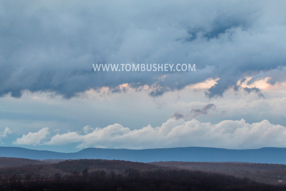 Hamptonburgh, New York - Clouds move over the the landscape in a view from Thomas Bull Memorial Park on Aprl 22, 2015.
