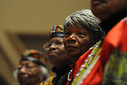 """Juanita Harris listens to a homily from Rev. Andrew Smith during the 33rd Annual African American Heritage Month Eucharistic Celebration at Holy Name Cathedral. This year's mass celebrates the the Nguzo Saba principle of Kuumba, or """"creativity"""" at Holy Name Cathedral."""