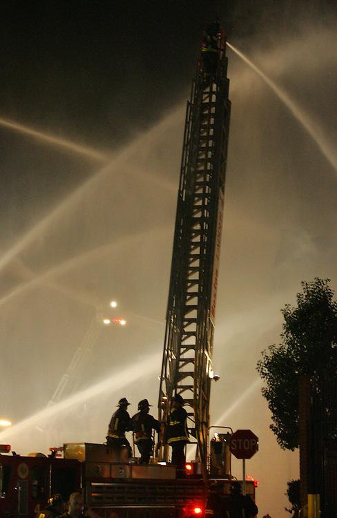 Boston, MA 08/21/2010.Boston's Ladder 4 mounts an aerial attack at a 9 alarm fire at 31 Norfolk Ave in Roxbury on Saturday night, August 20, 2010..Alex Jones / www.alexjonesphoto.com
