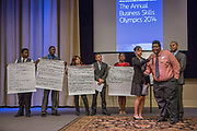 Purchase, NY – 31 October 2014. The team from Alexander Hamilton High School presenting their case. (Left to right: Stefan Mirtil, Michael Mirtil Jr , Lynce Baltazar, Steeven  Bermal,   Sarin Sajan Itty, Sadé Whittier, Tyler Burns, Christopher Clough.) Alexander Hamilton High School placed third in the 2014 competition. The Business Skills Olympics was founded by the African American Men of Westchester, is sponsored and facilitated by Morgan Stanley, and is open to high school teams in Westchester County.
