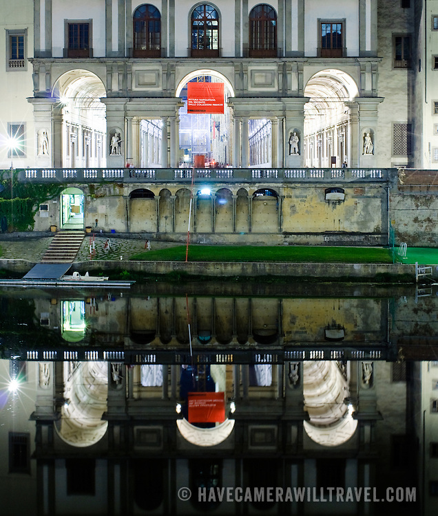 Galleria degli Uffizi at night reflected on the Arno River