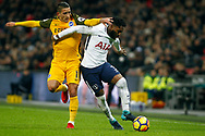 Anthony Knockaert of Brighton & Hove Albion (L) tussles with Danny Rose of Tottenham Hotspur (R). Premier league match, Tottenham Hotspur v Brighton & Hove Albion at Wembley Stadium in London on Wednesday 13th December 2017.<br /> pic by Steffan Bowen, Andrew Orchard sports photography.
