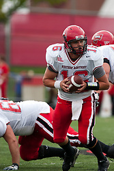 08 OCT 2005 WKU Hilltopper QB Justin Haddix looks for a running back. The Illinois State University Redbirds roped and tied the Western Kentucky University Hilltoppers in regulation but loosened the noose in Overtime as the Hilltoppers take the honors with a 37 - 24 Victory in Gateway Conference action at Hancock Stadium on Illinois State's campus in Normal IL.