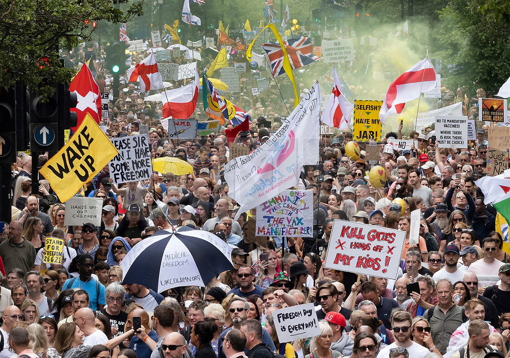 © Licensed to London News Pictures. 26/06/2021. London, UK. Thousands of anti-lockdown protesters march along Oxford Street, central London. Various groups are marching in central London today calling for freedom and an end to lockdown regulations. Photo credit: Peter Macdiarmid/LNP
