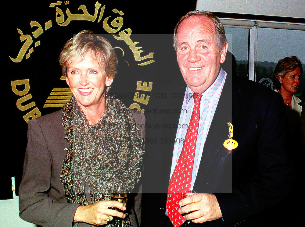 MR & MRS RICHARD HANNON he is the race horse trainer, at a race meeting in Berkshire on 19th September 1999.MWM 17