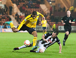 Falkirk's Lyle Taylor and Dunfermline's Andy Dowie..Dunfermline 0 v 1 Falkirk, 26/12/2012..©Michael Schofield.