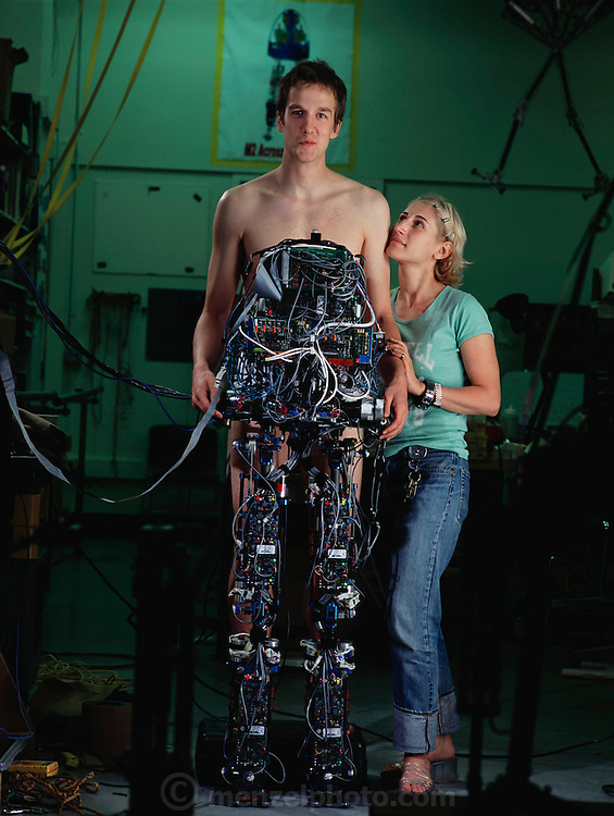 Dan Paluska, the mechanical engineering grad student leading M2's hardware design and construction stands with his girlfriend, Jessica, at MIT Leg Lab, Cambridge, MA.