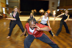 Dance class for teenager girls in a secondary school; Yorkshire UK