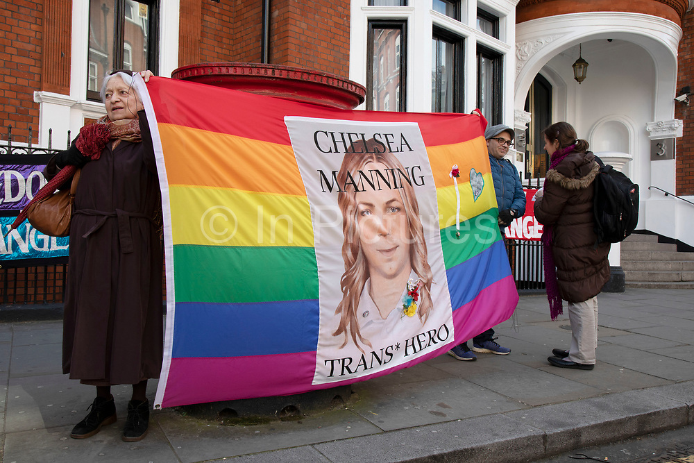 People holding a rainbow flag depicting Chelsea Manning, the American activist and whistleblower, outside the Ecuadorian Embassy on 5th April 2019 in London, England, United Kingdom. Their presence comes as Wikileaks has announced that their founder Julian Assange may be expelled from the Embassy within hours or days.