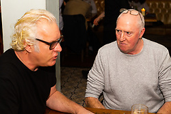 Paul Greendale, left, a remain-voting musician and producer discusses Brexit with Philip Davenport, right, a construction worker and ardent brexiteer at the Whippet Inn in North West London . London January 13 2019.