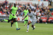 Andre Ayew of Swansea city ® in action. Barclays Premier league match, Swansea city v Manchester city at the Liberty Stadium in Swansea, South Wales on Sunday 15th May 2016.<br /> pic by Andrew Orchard, Andrew Orchard sports photography.