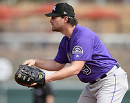 GLENDALE, ARIZONA - MARCH 02:  Daniel Murphy #9 of the Colorado Rockies fields against the Chicago White Sox on March 2, 2019 at Camelback Ranch in Glendale Arizona.  (Photo by Ron Vesely)  Subject:  Daniel Murphy