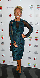 EMELI SANDE at a party hosted by Beats by Dre to celebrate the launch of Tinie Tempah's new album and to celebrate his birthday held at DSTRKT, Rupert Street, London on 7th November 2013.
