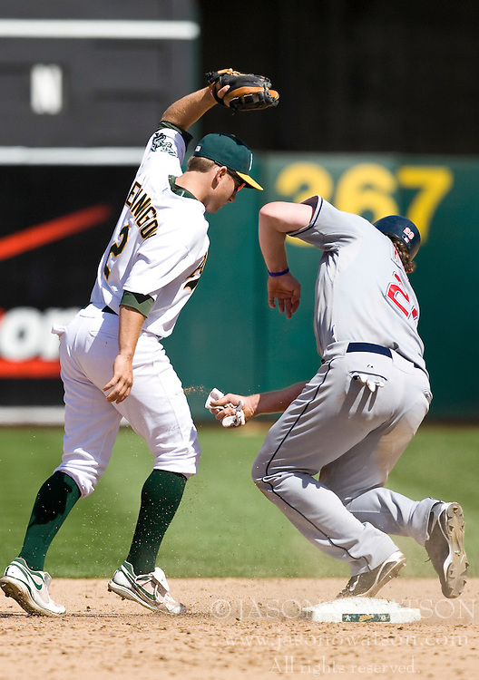 April 24, 2010; Oakland, CA, USA;  Oakland Athletics shortstop Cliff Pennington (2) forces out Cleveland Indians right fielder Austin Kearns (26) at second base during the ninth inning at Oakland-Alameda County Coliseum.  Cleveland defeated Oakland 6-1.