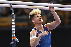 August 18, 2018 - Boston, Massachussetts, U.S - DONOTHAN BAILEY chalks up the parallel bars during the final round of competition held at TD Garden in Boston, Massachusetts. (Credit Image: © Amy Sanderson via ZUMA Wire)