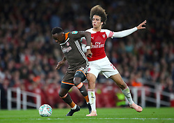 Brentford's Moses Odubajo (left) and Arsenal's Matteo Guendouzi battle for the ball during the Carabao Cup, Third Round match at the Emirates Stadium, London.