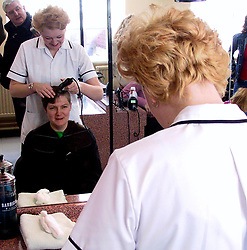 Julie McKenzie has her head shaved by NVQ level nII student Cheryl Denman at Doncaster college to raise money from Breast cancer charity<br /><br />Thursday 28 Feb 2002