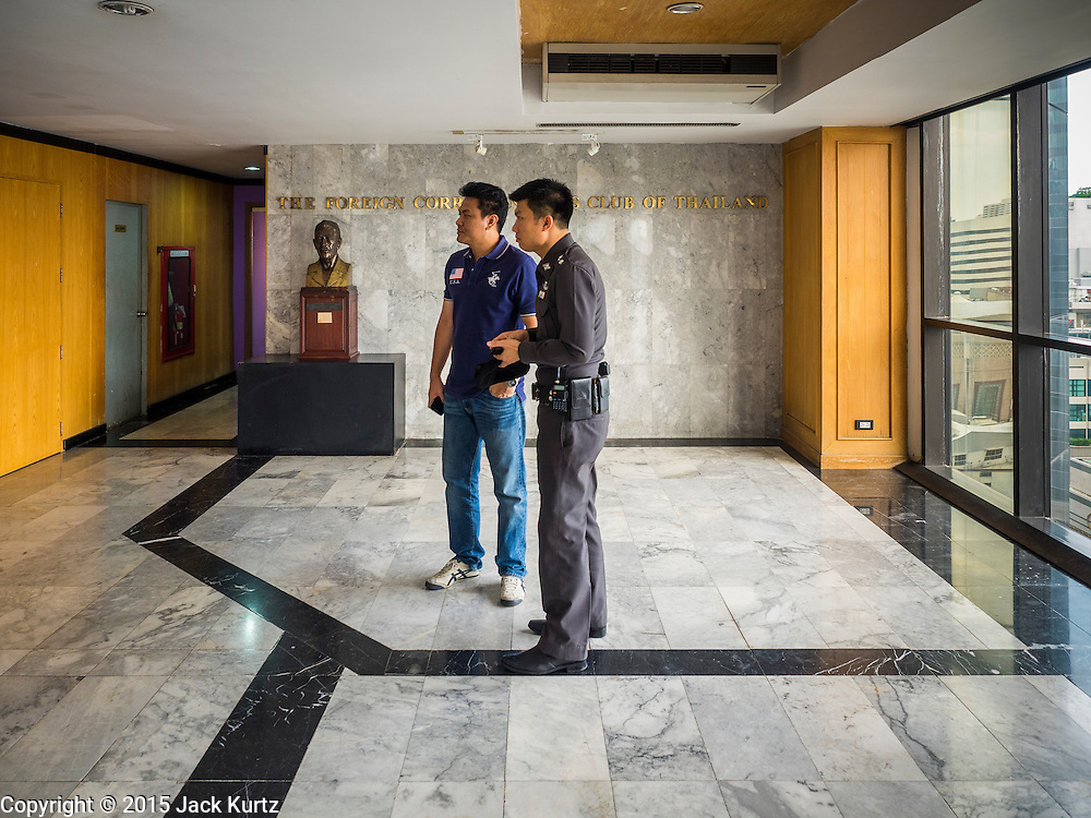 """26 JUNE 2015 - BANGKOK, THAILAND:  Thai police in the lobby of the Foreign Correspondents' Club of Thailand after they cancelled the release of a Human Rights Watch (HRW) report, """"Persecuting 'Evil Way' Religion: Abuses against Montagnards in Vietnam"""", at the Foreign Correspondents' Club of Thailand (FCCT) in Bangkok Friday morning. The report made no mention of the human rights situation in Thailand. The Thai Ministry of Foreign Affairs (MFA) contacted HRW Thursday afternoon and asked them to cancel the program because it was a """"sensitive"""" matter that could impact on Thai-Vietnam relations. HRW told the MFA that they would go ahead with the report's release. Friday morning, before the report was scheduled to be released, Thai police officers arrived at the FCCT and cancelled the event. Phil Robertson, deputy director of Human Rights Watch's Asia division, said, """"By stepping in to defend a neighboring state's human rights violations against a group of its people and interrupting a scheduled press conference, Thailand's military junta is violating freedom of assembly and demonstrating its contempt for freedom of the press.""""      PHOTO BY JACK KURTZ"""