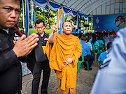 11 AUGUST 2015 - BANGKOK, THAILAND: A Buddhist monk sprinkles people with holy water during a service to honor Queen Sirikit of Thailand before her 83rd birthday. Queen Sirikit was born Mom Rajawongse Sirikit Kitiyakara on August 12, 1932. She is the queen consort of Bhumibol Adulyadej, King (Rama IX) of Thailand. She met Bhumibol in Paris, where her father was the Thai ambassador. They married in 1950, she was appointed Queen Regent in 1956. The King and Queen had one son and three daughters. She has not made any public appearances since her hospitalization in 2012. Her birthday is celebrated as Mother's Day in Thailand, schools and temples across Thailand hold ceremonies to honor the Queen and mothers.       PHOTO BY JACK KURTZ