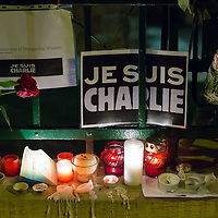 Flowers and candles in support of the Charlie Hebdo satirical weekly lay on the ground in front of the French Embassy in Budapest, Hungary on January 08, 2015. ATTILA VOLGYI