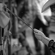 A rider applies fresh rosin to his bull rope before the 2016 Darby MT EPB.  Josh Homer photo.  Photo credit must be given on all uses.