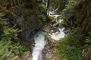 Cascade Creek underneath the Cascade Falls suspension bridge in Cascade Falls Regional Park near Mission, British Columbia, Canada