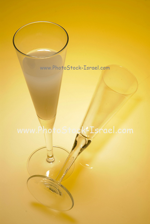 An elegant glass of grapefruit juice on a yellow background