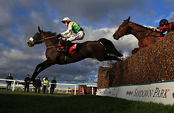 Touch Kick ridden by Harry Cobden jumps the last to win the MS Amlin Insurance Novices' Limited Handicap Steeple Chase during day one of the Betfair Tingle Creek Christmas Festival at Sandown Park Racecourse.