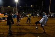 Honduran migrants, part of the Central American migrants' caravan, play soccer at at the Unidad Deportiva Benito Juarez in Tijuana, Mexico on November 21, 2018.