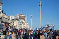 Open top buses pass by the British Airways i360 during the Brighton & Hove Albion Football Club Promotion Parade at Brighton Seafront, Brighton, East Sussex. United Kingdom on 14 May 2017. Photo by Ellie Hoad.