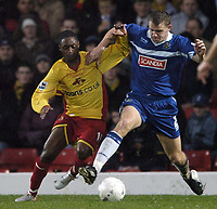 Photo: Jonathan Butler.<br />Watford v Stockport County. The FA Cup. 06/01/2007.<br />Robert Clare of Stockport holds off Anthony McNamee of Watford.