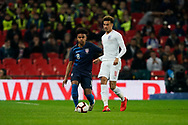 Weston McKennie of USA under pressure from Dele Alli of England during the International Friendly match between England and USA at Wembley Stadium, London, England on 15 November 2018.