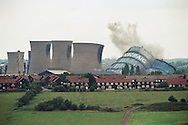 'Demolition Day, 2014'  from the project 'The Fall and Rise of Ravenscraig' by photographer Colin McPherson.<br /> <br /> Image shows the demolition of the gas holder and cooling towers at Ravenscraig steel works, Motherwell on 28th July 1996, four years after the plant was closed down..<br /> <br /> This project, photographed in 2014, looks at the topography of the post-industrial landscape at Ravenscraig, the site until its closure in 1992 of the largest hot strip steel mill in western Europe. In its current state, Ravenscraig is one of the largest derelict sites in Europe measuring over 1,125 acres (4.55 km2) in size, an area equivalent to 700 football pitches or twice the size of Monaco. It is currently being developed with a mix of housing, retail and the home of South Lanarkshire College and the Ravenscraig Regional Sports Facility.