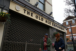 © Licensed to London News Pictures. 22/02/2021. London, UK. A couple walks past The Old Ale Emporium, a pub in Haringey, north London, on the day Prime Minister will announce the government's plans for relaxing Covid-19 restrictions in England. Boris Johnson will address the House of Commons at 3.30pm followed by a Downing Street news conference at 7pm. It is expected that shops, restaurants, hairdressers and pubs will reopen mid April. Photo credit: Dinendra Haria/LNP