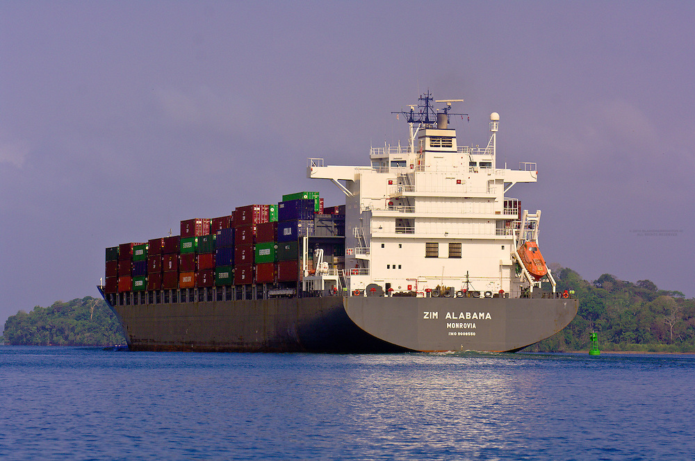 Container ship passing through the Panama Canal (Gatun Lake), Panama