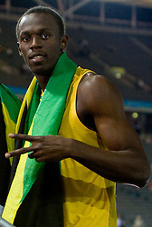 Usain Bolt   of Jamaica celebrates winning the gold medal in the mens 4x100 Metres Relay Final with mascot Berlino during day eight of the 12th IAAF World Athletics Championships at the Olympic Stadium on August 22, 2009 in Berlin, Germany. (Photo by Vid Ponikvar / Sportida)