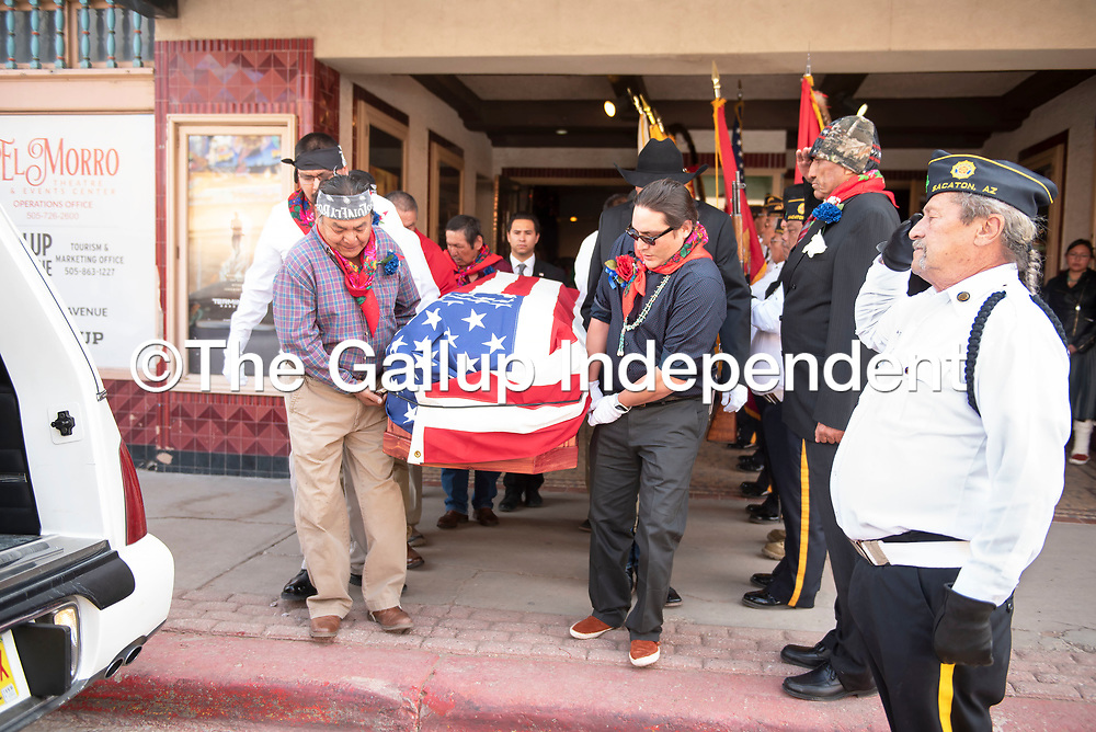 Pallbearers carry the casket of Navajo Code Talker Joe Vandever Sr. out of El Morro Theatre following his funeral service Wednesday in Gallup. Vandever was laid to rest at the Santa Fe National Cemetery Thursday in Santa Fe,  New Mexico.