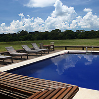 South America, Brazil, Pantanal. The swimming pool and deck of Cordilheira Lodge at the Caiman Ecological Reserve.