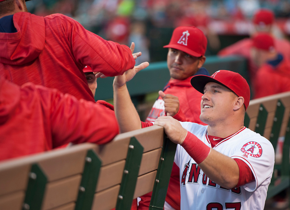 The Angels' Mike Trout greets teammates before playing the St. Louis Cardinals Tuesday at Angel Stadium.<br /> <br /> ///ADDITIONAL INFO:   <br /> <br /> angels.0511.kjs  ---  Photo by KEVIN SULLIVAN / Orange County Register  --  5/10/16<br /> <br /> The Los Angeles Angels take on the St. Louis Cardinals at Angel Stadium Tuesday.<br /> <br />  5/10/16
