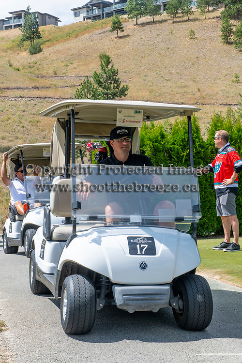 KELOWNA, CANADA - JULY 21: Kris Mallette drives the golf cart at the Kelowna Rockets Alumni golf tournament at Black Mountain Golf Club in Kelowna, British Columbia, Canada.  (Photo by Marissa Baecker/Shoot the Breeze)  *** Local Caption ***
