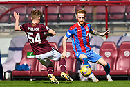 Finlay Pollock (#54)) of Heart of Midlothian FC tackles David Carson (#8) of Inverness Caledonian Thistle FC during the SPFL Championship match between Heart of Midlothian and Inverness CT at Tynecastle Park, Edinburgh Scotland on 24 April 2021.
